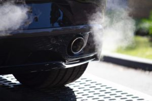 Exhaust coming out of an SUV's tailpipe.