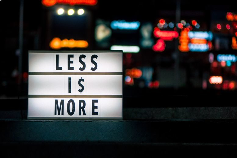 A sign that says less is more