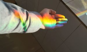 a man's hand covered in refracted light