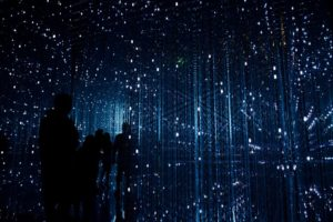 silhouettes of people against a starry background