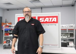 Tony standing in front of a SATA sign
