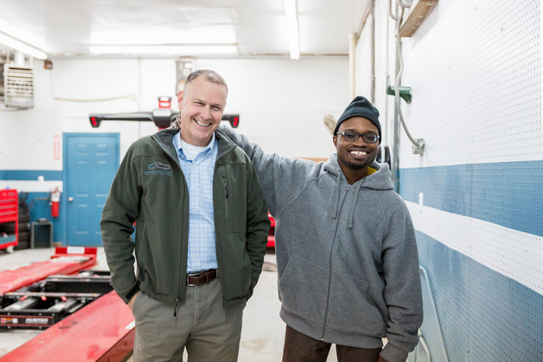 TAKING A CHANCE: Kevin Conner (left) has advanced his four shops by joining programs at local universities which has resulted in hires like Maurice Gray (right).