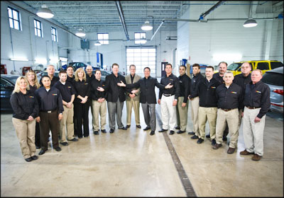 ONE BIG FAMILY—CARCARE CEO Bill Aeschliman, center, says human capital is most important. Employees are treated like family. Photo by Mike Boyd
