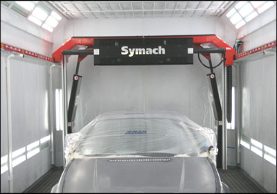 The Robodry system sits on a set of parallel rails that run the length of a spray booth.  An arch along the top houses a set of gas solutions, solenoids, air and motors. Photos courtesy Symach