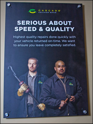 PROUD OF EMPLOYEES: The faces of staff members are a key part of Cascade Collision Repair's branding strategy, and they are prominent on posters in all of the company's facilities. Consistency in colors and shop design are also important. Photos by Torsten Bangerter