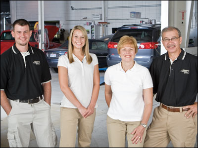 A family affair: Dingman's Collision Center. (Left to right) Andy Dingman, co-owner and general manager, his sister Darcie Dingman, who handles human resources and marketing, his mother Diana Dingman, who does the shop's books, and Boyd Dingman, whose father Francis opened the shop in 1960. Photo courtesy Dingman's Collision Center