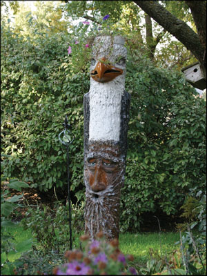 ARTISTIC: Body shop owner Bob Long's two large gardens contain some kitschy works of art he's fashioned out of Bondo. Photo courtesy Bob Long