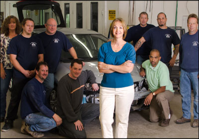 QUICK STUDY: Since struggling with their first hybrid in 2003, Donna Borges and her Colonial Auto Body staff have embraced the new technology.