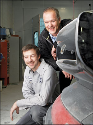 New Knowledge:  Brad Young, right, hired Peter McCallum for his experience with Mercedes-Benz cars after Star Motors body shop changed dealership affiliations. Photo by Perry Zavitz