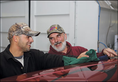 Family Affair: Shane DeRusha, left, gets help in the shop from his father, Dean DeRusha, a mechanic. Photo by Tim Brody