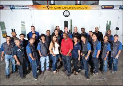 A COMMON GOAL: Nash (in red) and his team are dedicated to advancing the auto service industry in Hawaii. Photo by Tracy Wright-Corvo