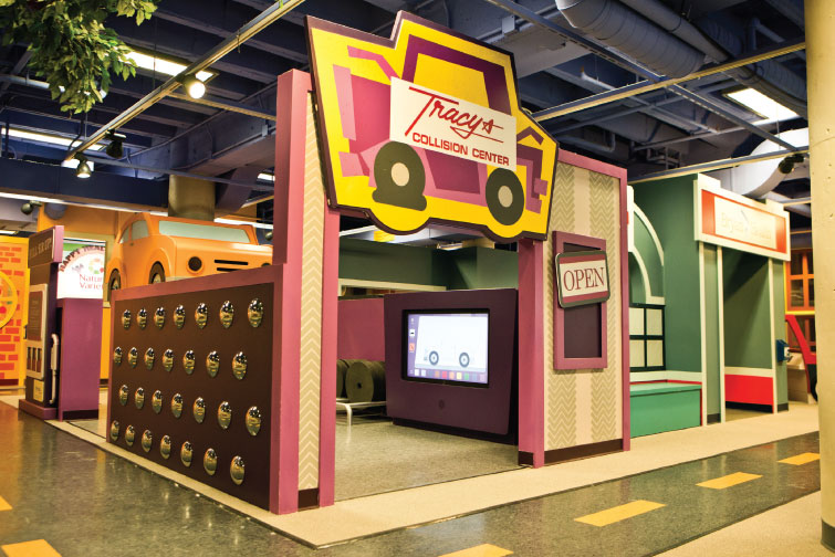 PUTTING IT ALL TOGETHER: Tom Tracy and Tracy's Collision helped the Lincoln (Neb.) Children's Museum build a permanent auto-themed exhibit. Photos by John Peterson