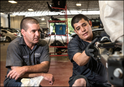 A HELPING HAND: Fernando Gonzalez (right) often assists other techs in the shop—many older than he is—and helps pass along the knowledge he's learned throughout his career. Photo by Jensen Hande