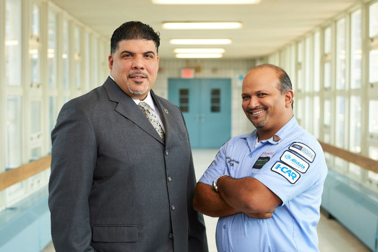 DOUBLE FOCUS: Moses Ojeda, left, and Barry Roopnarine have worked to transform the struggling collision program at their New York high school into one of the industry's premier technical education institutions. Photo by Kent Meister