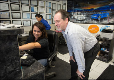 CREATING CONVENIENCE: New Look Collision Center owner Michael Whittemore with customer service representative Emma Vogt. The shop processes about a dozen mobile estimates a day through a form on its website.