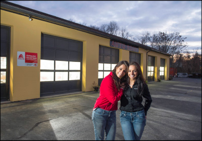 A MORE INVITING FACILITY: Adriana (right) and Sabrina Indomenico began by updating the exterior, which included getting rid of the old vehicles, used parts and weeds that littered the back lot.