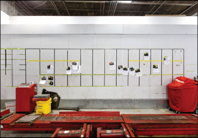 A VISUAL REMINDER: One of Phillippi's techs came up with the idea for this workflow board pasted on the backside of the paint booth. Photo by Michael Boyd