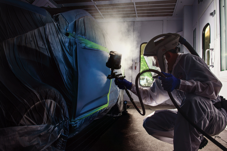 Painter Jason Fortner at Columbia Auto Center in Columbia, Md. Photo by Kathy Hertel